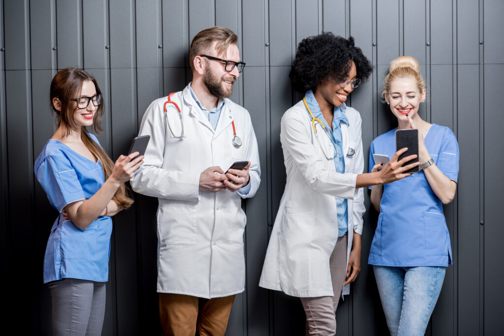 Doctors and nurses with phones