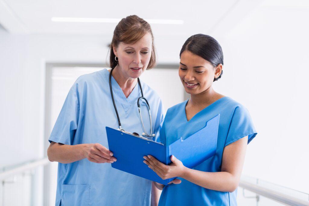 Nurses with clipboard talking
