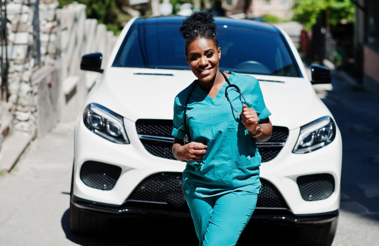female healthcare in front of car