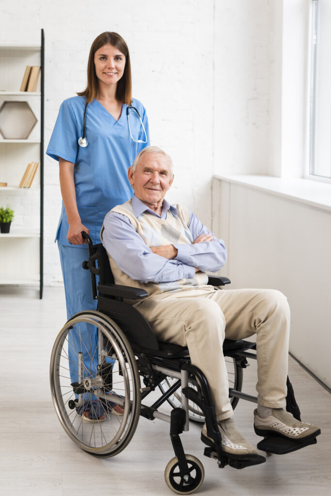 Nurse with man in wheelchair smiling